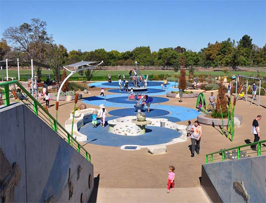 The water feature marks the beginning of the slough shaped pathway that encloses the play activities.