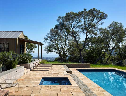 The design of the pool area allowed for dramatic views to the east, between the oak groves.