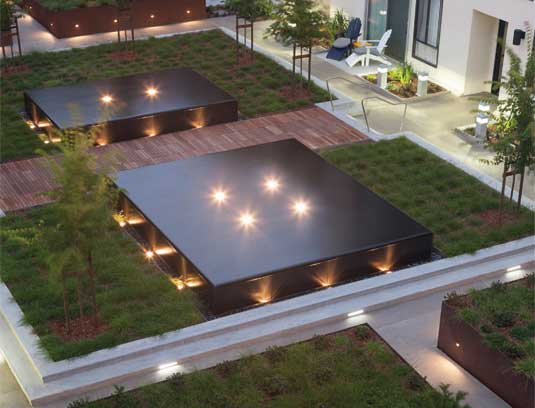 view of courtyard A/B from the roof with polished basalt clad water tables, concrete and corten metal planters.