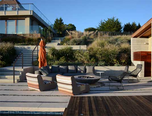 A custom firepit extends terrace use and becomes a destination from uphill.
