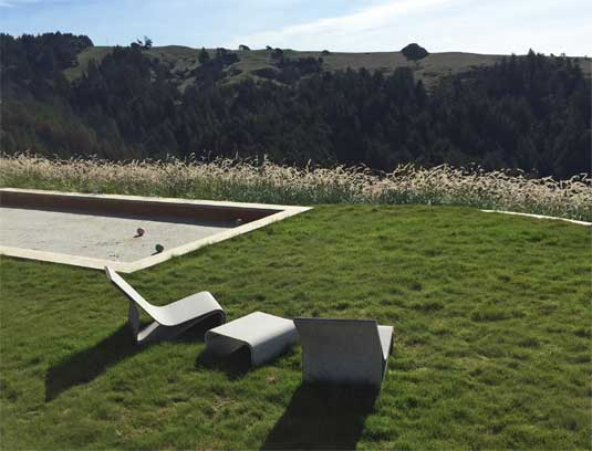 A grassy area accompanies the bocce court; a space for socializing or relaxation.