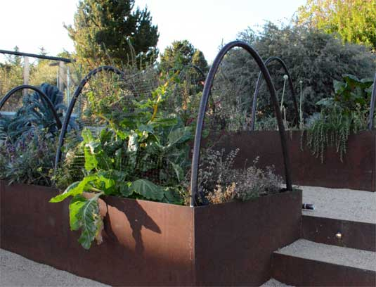 cor-Ten planters and steps give a contemporary aesthetic to a traditional pursuit.