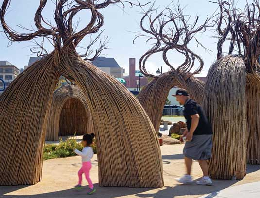 Willow structures designed by a local artist create a fanciful maze.