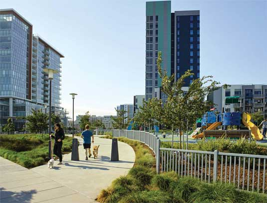 Pathways in the park allow community residents to stroll through and take their dogs for a walk.