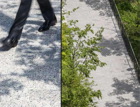 DETAIL: 5 million pedestrian trips per year warranted the use of a durable paving material. Granite pavers in a subtle mix of color and finish were used to mimic the shadow patterns overlapping the paving throughout the day.