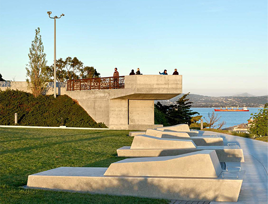 An intervention into the landscape that creates a compelling choreography of views through rotating orientations, multiple sculptural seating elements, and a dramatic overlook structure.
