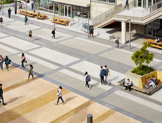 Paving patterns delineate movement and create rhythm at a pedestrian scale.