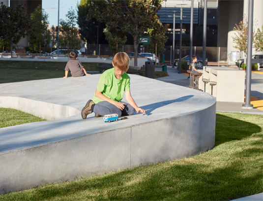 The sculpture creates space for soaking up sun or watching community events on the sloped lawn and becomes the canvas for children's imagination games.