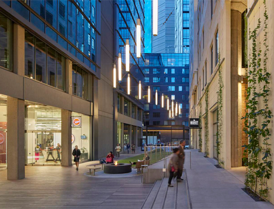 Redeveloping a former alley into a plaza and urban corridor transforms the complex into an urban campus.