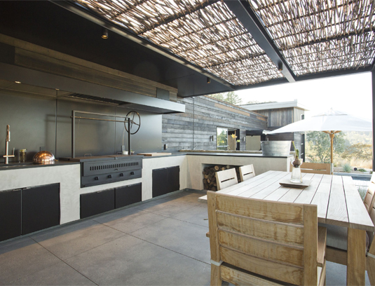 Outdoor Kitchen. The outdoor kitchen features a custom wood rotisserie grill.