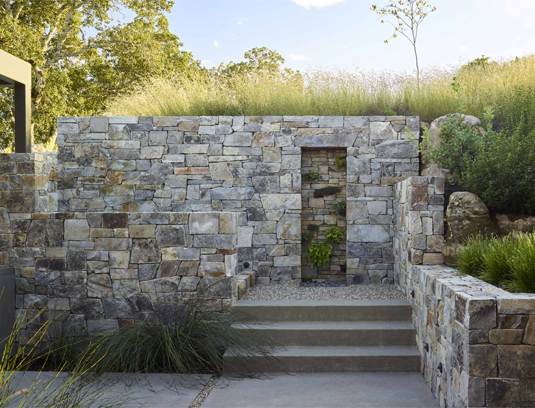 Stone and gravel steps leading up to the top level feature a planted grotto at the midway landing, with Adiantum r. 'Pacific Maid', Leptinella s. 'Platts Black', Viola labradorica and Campanula murallis.