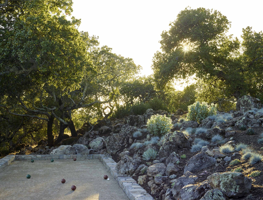 The bocce court laid into a gap in the native rock outcroppings in the Moon Garden, featuring Festuca i.'Siskiyou Blue', Cotyledon o. 'Flavida', Eriogonum giganteum, and Dudleya hydrids.