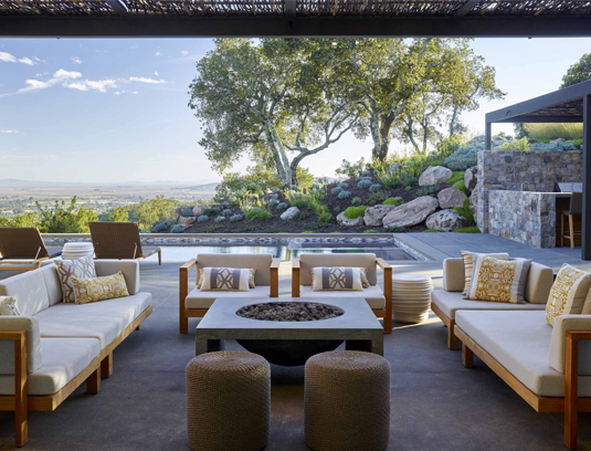 The great room fully open to the pool terrace. The rural contemporary compound was carefully sited and stepped to take best advantage of limited level space.