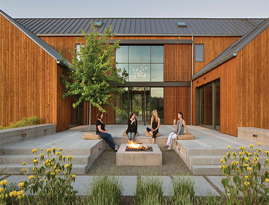 The fire-pit lounge terrace is another outdoor room sculpted by the design team. It embodies Napa Valley style with its clean lines with rustic accents.