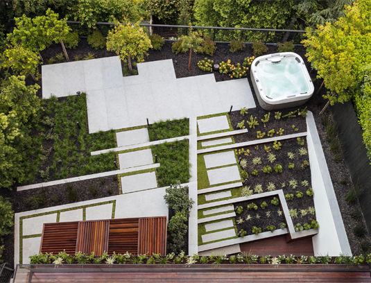 Aerial View of Back Garden. Staggered steps and terraces link the house to the garden on three levels. Bold, linear plantings accent the hardscape and create a striking view for the main living level and bedroom decks above.