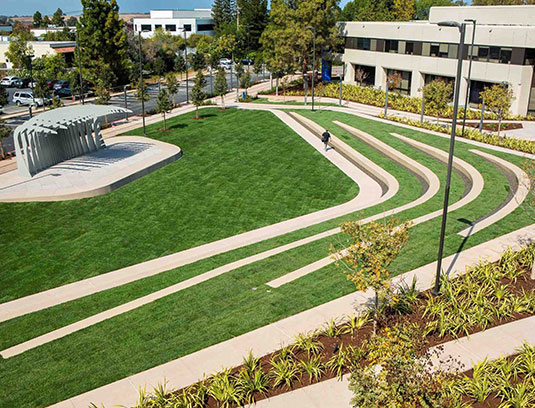 The Village Green amphitheater is a converted parking lot with capacity for about 3,000 people. In order to reduce water use, the lawn is irrigated with a subsurface system typically used in professional sports fields.