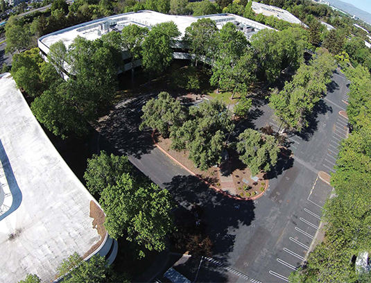An aerial view of the site prior to consruction. This project transformed an outdated parking lot into an active landscape merging people, ecology, and infrastructure.
