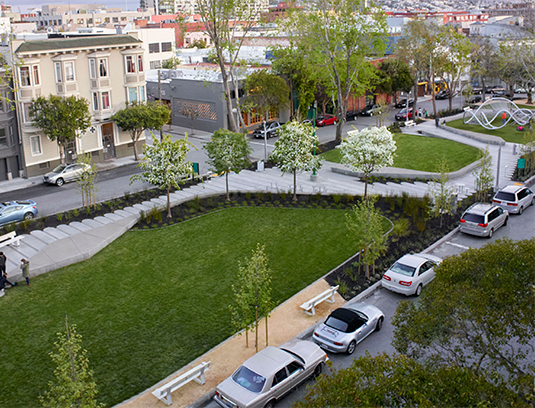 The path system is comprised of site-cast, monolithically poured concrete tablets and sliders. The path responds to a variety of conditions across the site, shifting to accommodate contextual desires while maintaining a coherent modulation across the site. The 6 wide sliders become curbs, headers, and trenchdrains.